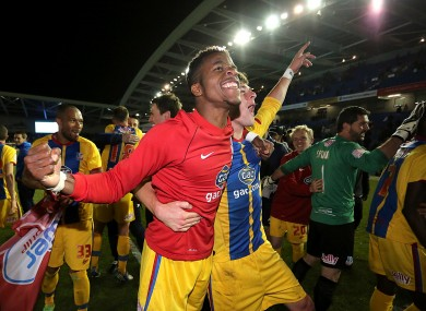 Crystal Palace's Wilfried Zaha (left) celebrates with his team-mate Joel Ward after the final whistle.
