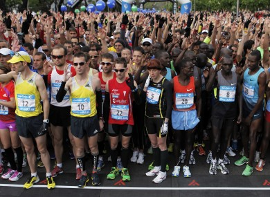 Runners observe a moment of silence to honour Boston Marathon bombings victims as they take part in the 36th edition of the Madrid Marathon.