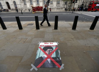 A poster with a photo of Ayatollah Ali Khamenei, Iran's Supreme Leader, placed by Iranian activists protesting against their government in London on Wednesday