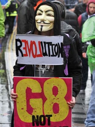 File: A G8 Not Welcome protestor on 15 June