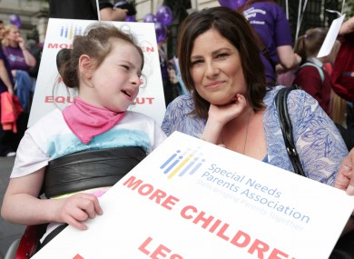 Lorraine Dempsey and her daughter Rianna (10) from Wicklow protest outside Leinster House this evening
