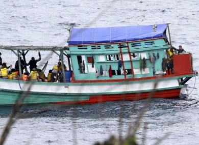Photo taken on 14 April, shows a fishing boat carrying Vietnamese asylum seekers near the shore of Australia's Christmas Island.