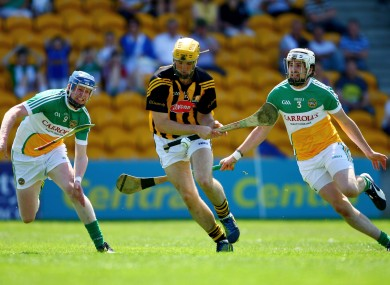 Kilkenny's Colin Fennelly with Offaly's David Kenny and Dermot Mooney.