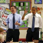 Teaching kids about the G8 summit together at Enniskillen Integrated Primary School. (AP Photo/Evan Vucci)