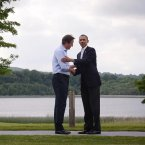 David Cameron and Barack Obama embrace as they meet at this year's G8 Summit on Lough Erne, Enniskillen in Northern Ireland. (AP Photo/Evan Vucci)