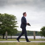 Prime Minister David Cameron leaves after holding a press conference at the end of this year's G8 Summit on Lough Erne near Enniskillen in Northern Ireland.