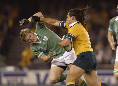 George Smith knocks Brian O'Driscoll aside in the 2003 World Cup.