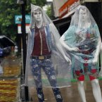 Mannequins are covered with plastic as it rains in Mumbai, India. The monsoon rains which usually hit India from June to September are crucial for farmers whose crops feed hundreds of millions of people. (AP Photo/Rafiq Maqbool)