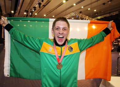 Ireland's Jason Quigley celebrates with his gold medal.