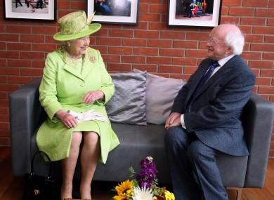 Queen Elizabeth II meets Irish President Michael D. Higgins during a visit to the Lyric Theatre in Belfast.