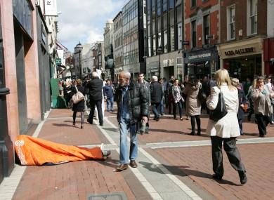 Homeless man on Grafton Street, Dublin.