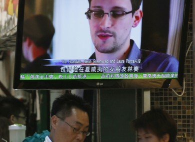 A TV screen in Hong Kong shows a news report on Edward Snowden, the former CIA employee who leaked top-secret documents about US surveillance programs.