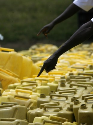 Aid workers count water containers as displaced Congolese who fled to the south east of Rutshuru