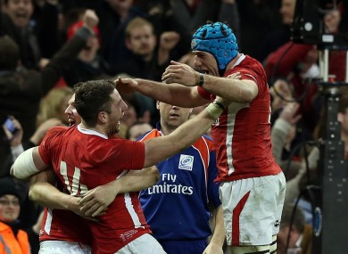 Alex Cuthbert and Justin Tipuric celebrate the winger's try against England.