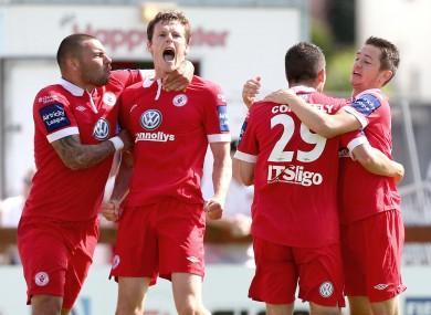Evan McMillan celebrates scoring a late equaliser for Rovers.
