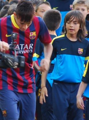 Neymar performs some tricks while Zak Gilsenan looks on.