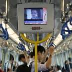 A TV screen shows the news of Edward Snowden, in an underground train in Hong Kong (AP Photo/Kin Cheung).