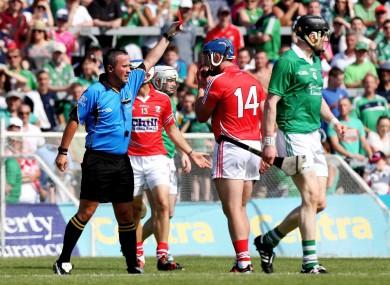 Referee James McGrath red cards' Patrick Horgan of Cork.