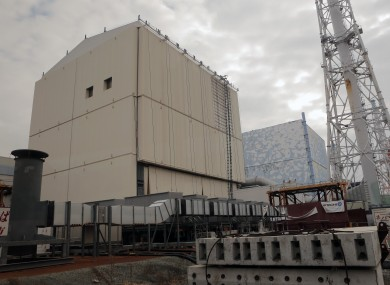 Dec. 29, 2012 file photo, the Unit 1 reactor building, left, and Unit 2 of the Fukushima Dai-ichi nuclear power plant