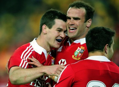 Jonathan Sexton celebrates with Jamie Roberts.