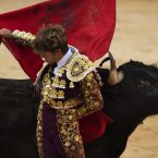 Spanish bullfighter Manuel Escribano performs with a Dolores Aguirre fighting bull during a bullfight of the San Fermin festival, in Pamplona, Spain. (AP Photo/Daniel Ochoa de Olza)