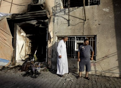 Civilians inspect the aftermath of a car bomb attack in the neighborhood of Tobjee in Baghdad last Sunday.
