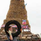 Jack Lindsay,12, with a tyre beside the huge bonfire at New Mossley on the outskirts of Belfast. Paul Faith/PA<span class=
