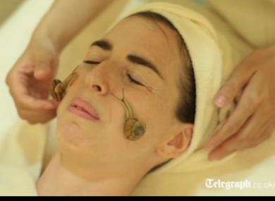 Reporter Danielle Demetriou enjoying (?) the snail facial.