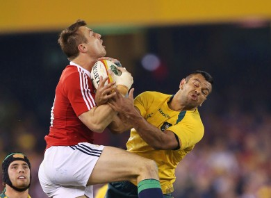 Tommy Bowe wrests an aerial ball from Kurtley Beale.
