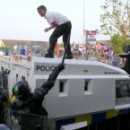 Loyalists confront police in north Belfast (Image: Paul Faith/PA Wire)