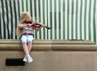 Fiddle player Mary Jo from Laois performs on the streets as part of the Fleadh Cheoil