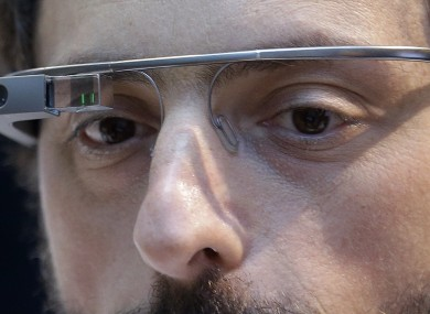 Google co-founder Sergey Brin wears a Google Glass device