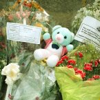Flowers and teddies for the men, women and children killed. Pic: Photocall Ireland