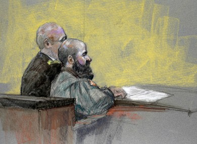 A courtroom sketch showing Nidal Hasan (right).