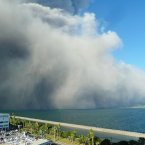 Volcanic smoke from Mount Sakurajima flow into an urban area in Kagoshima (Image: Kyodo News/AP).