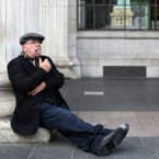 Barnie Muhall from Dublin enjoys a pipe before playing out the Bloody Sunday scene. <span class=