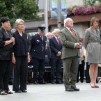 President Michael D Higgins pauses to remember those who died.<span class=