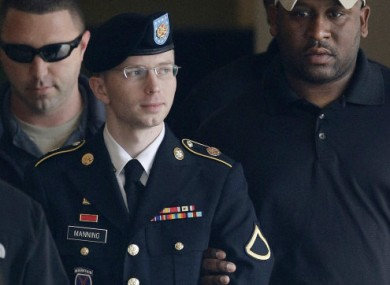 Army private Bradley Manning is escorted into a courthouse in Fort Meade Maryland yesterday.