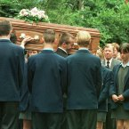 The coffin of Samantha McFarland, aged 17, is carried into Lislimnaghan Parish Church, past her friends from Strabane Grammar School. (AP Photo/Louisa Buller)
