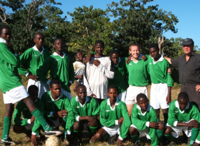 Volunteer Donncha O'Donnchadha with a local football team in Malawi.