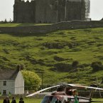 Queen Elizabeth II (right) and the Duke of Edinburgh (2nd right) arrive by Helicopter in Cashel, to visit the ancient Rock of Cashel, during her State Visit to Ireland. (John Stillwell/PA Archive/Press Association Images)