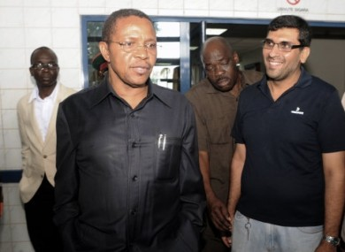 Tanzania President Jakaya Kikwete, left, accompanied with the Medical Director of Aga Khan Hospital-Dar es Salaam, Jaffer Dharsee, right, leave the hospital, after he had visited the two British women
