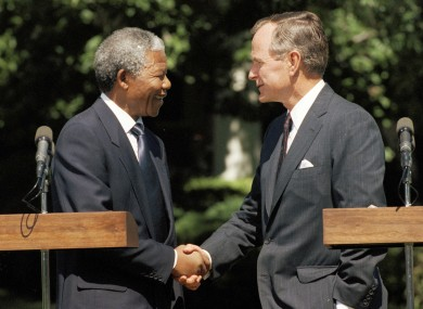 George HW Bush shaking hands with Nelson Mandela at the White House in 1990.