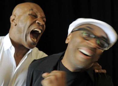 Mike Tyson takes a mock bite at the show's director, Spike Lee.