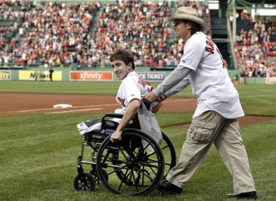 Jeff Bauman, Boston Marathon survivor with Carlos Arredondo at a sporting event some time after the attack.