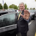 The Tánaiste leaves his party's think-in. <span class=