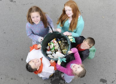 File: Drimnagh residents (L to R) Conor Ray (11), Sarah and Amy Neary (12), Martin Green (8) and Aoibheann Ray (7) take part in the National Spring Clean Campaign.