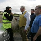 Charlie Allen of the Rodolphus Trust speaks to one of IBRC's security.<span class=