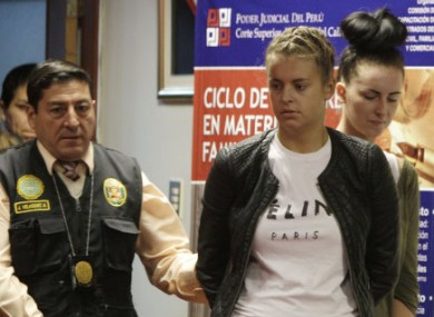 Melissa Reid is led to court in Peru last month.