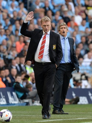 Manchester United manager David Moyes and City boss Manuel Pellegrini on the touchline